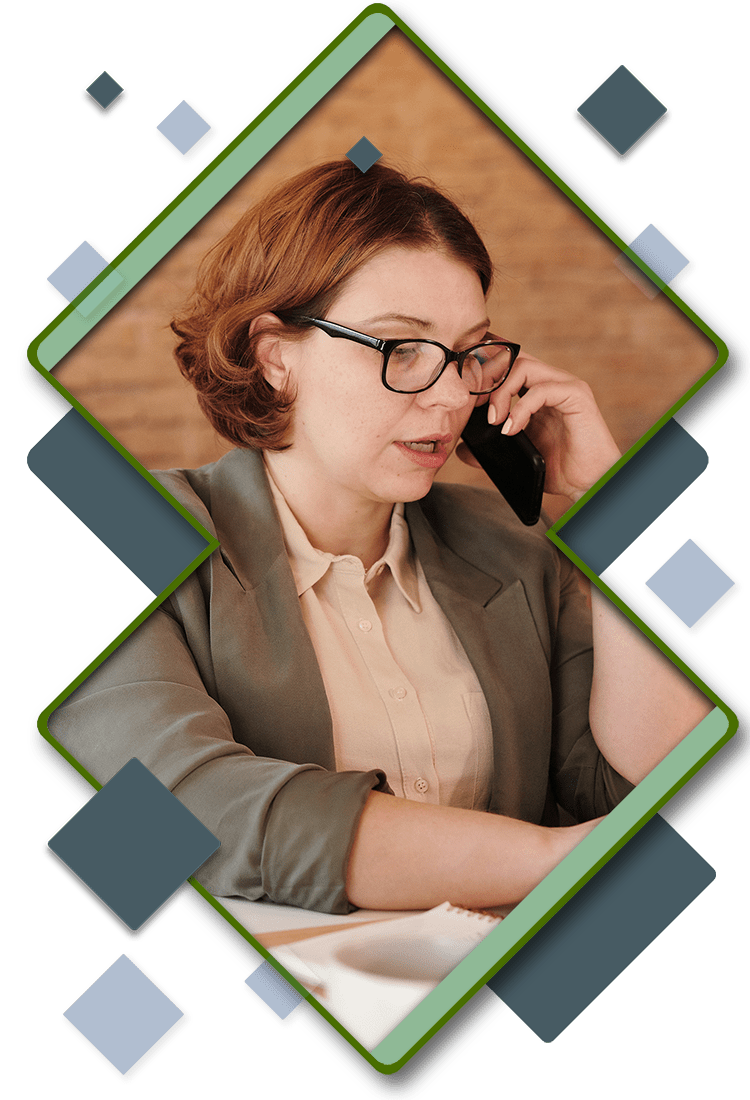A woman on the phone at her desk in a double diamond frame.