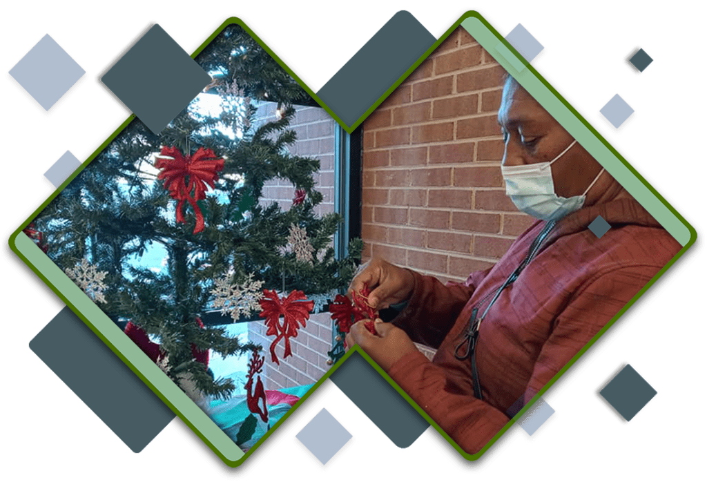 Resident decorating a Christmas tree.