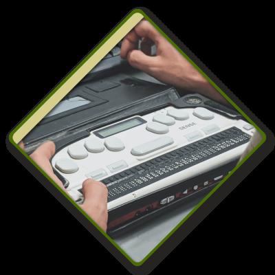 A closeup of a person using a BrailleSense notetaker in a diamond frame.