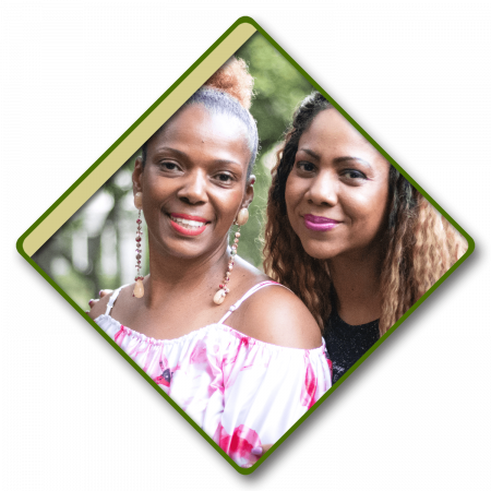 Two women, smiling together in a diamond frame.